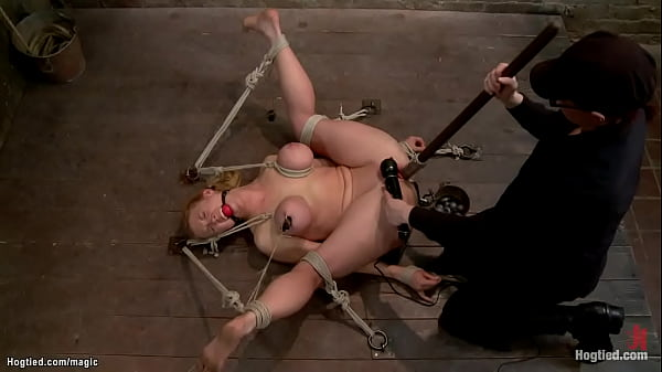 Hogtied blonde tied to pully whipped