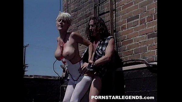 Huge tits nurse fucked hard on a rooftop