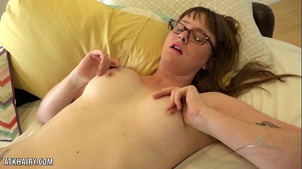 Thelma Sleaze rubs her hairy pussy raw