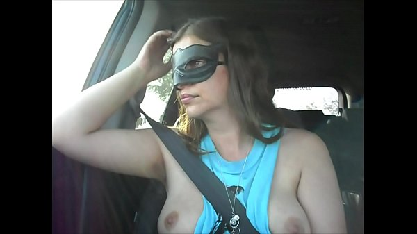 Miss Eva playing with her breasts and nipples in the car