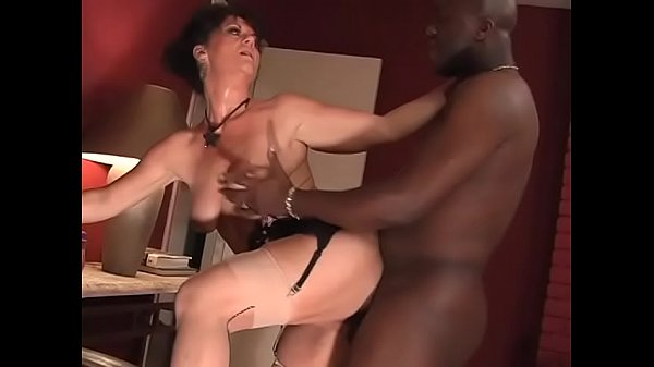Hot busty brunette mature woman in sexy lingeri...