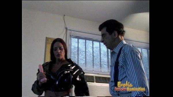 Ravishing raven-haired slut poses for the cameras wearing a huge strap-on
