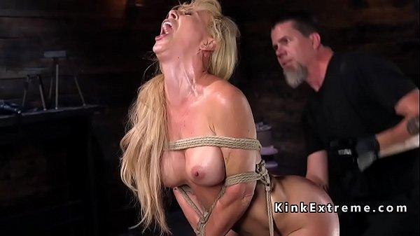 Hogtied blonde hanged in rope bondage