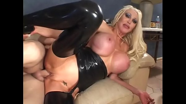 Guy fucks busty blonde latex babe in the throat