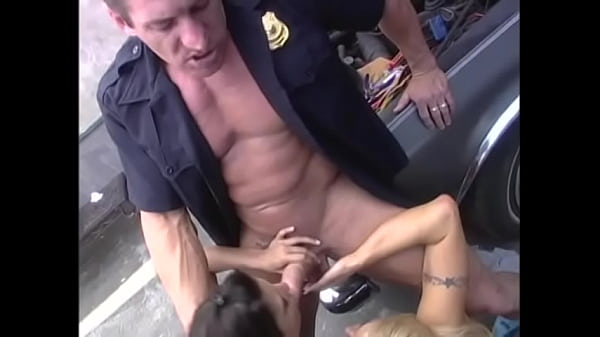 Naughty babes in short skirts seduce a muscular cop and take turns riding his hard cock