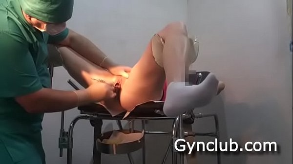 Examination on the gynecological chair of a dildo and a vibrator (04