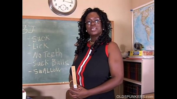 Sexy mature black teacher fucks her juicy pussy...
