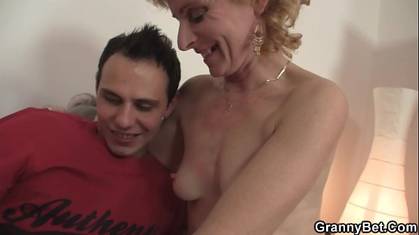 Skinny blonde granny spreads her legs Thumb