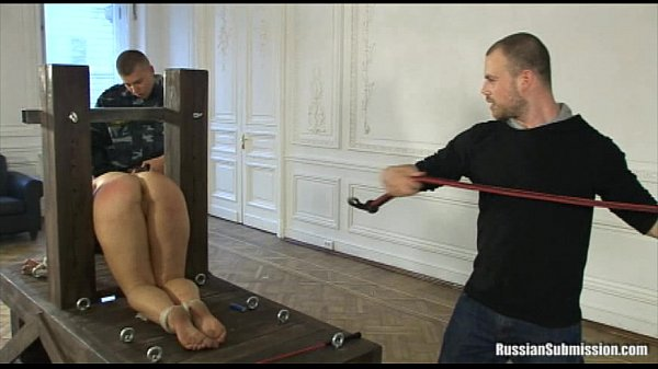 A puffy wife bound on her knees and a. by two cocks