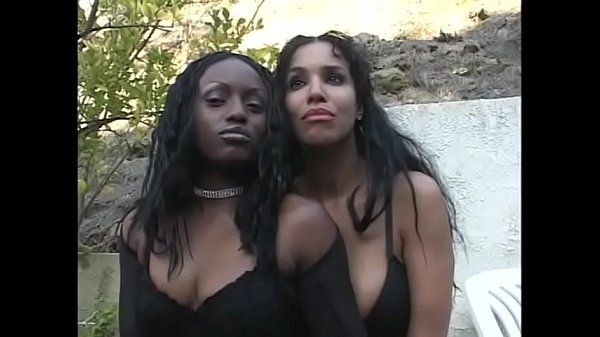 Two ebony honeys Soleil and Jada Fire share one hard cock in front of the fireplace