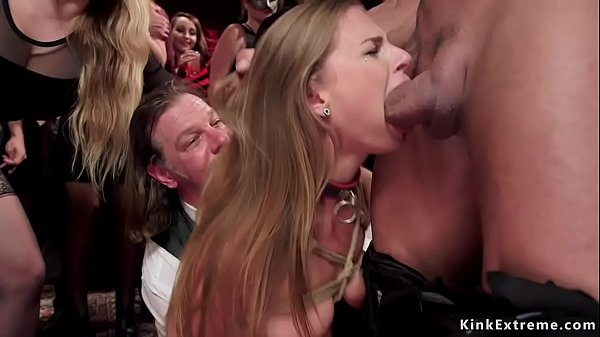 Two slaves licking mistress in orgy