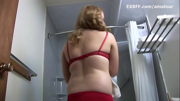 Blonde amateur strips out of bra and panties to...