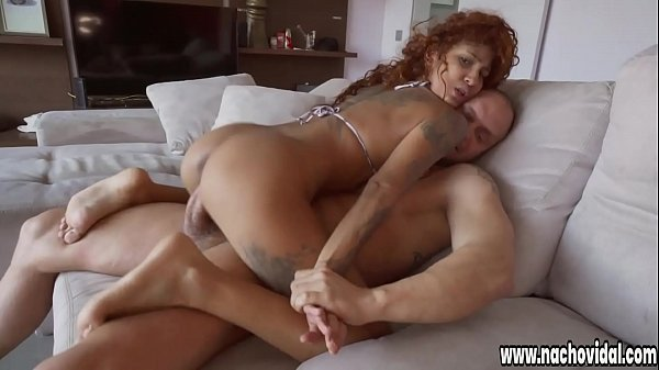 Venus Aphrodite shows big tits, delicious legs and tanned skin with many tattoos. She masturbates her pussy for Nacho Vidal, who pushes his huge cock in her cleavage.