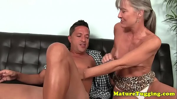 Mature slut tugs cock until a happy finish
