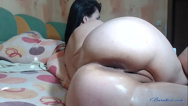 Brunette babe showing big ass and fisting pussy on webcam