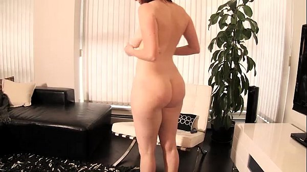 redhead strips and teases with great breasts and spreads her ass