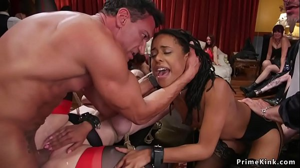 Ebony and brunette fucked in bdsm