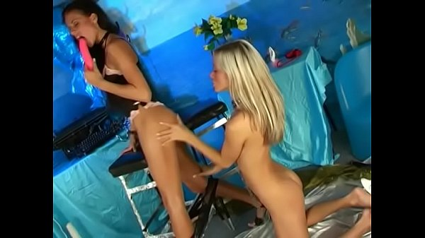 Blonde and brunette leasbians play with toys a...