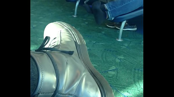 Mature man sockplay in airport terminal Thumb