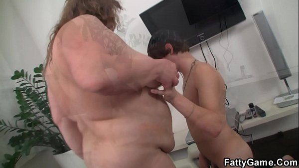 Big belly plumper rides young dude's cock