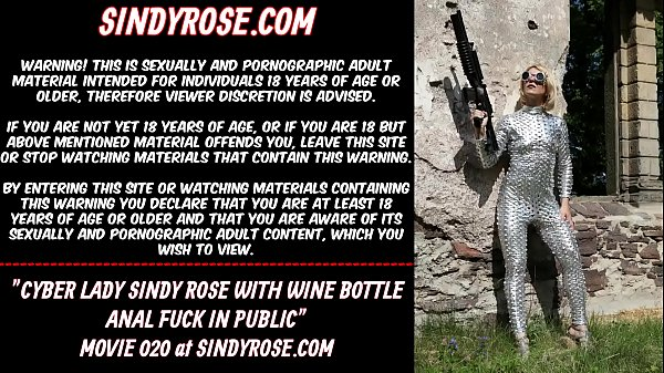 Cyber lady Sindy Rose with wine bottle anal fuck in public Thumb