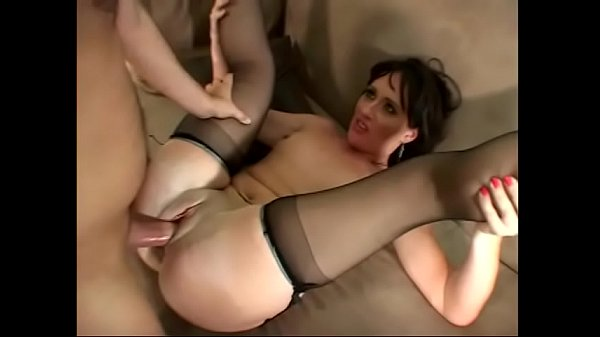 MILF Hollie Hughes with glasses rides a cock in her garter belt