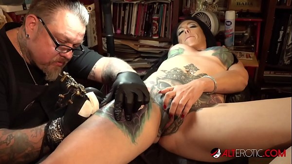 Marie Bossette touches herself while being tatt...