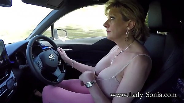 Mature blonde Lady Sonia plays with her tits while driving Thumb