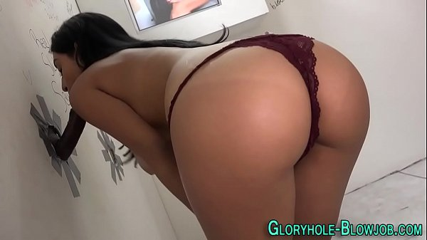 Busty babe gobbles cock
