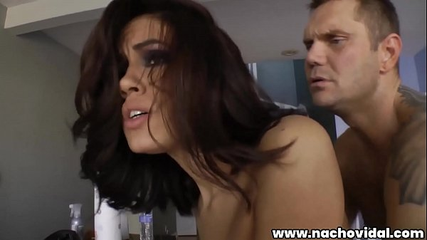 The latina wraps her lips around his enormous cock, then straddles Nacho and rides, her fine booty bouncing. After ferociously pounding Isis, Nacho spurts his load onto her jiggly butt cheeks.