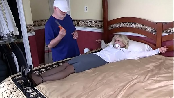 Amateur helpless in bed while clothes are cut off