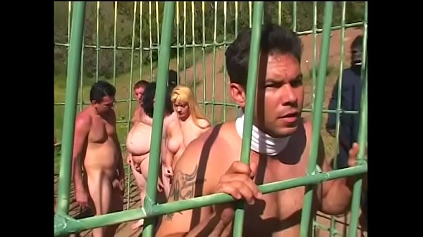 Young redhead wirth small tits Flick Shagwell and a dude fuck in a cage outdoors on the planet of monkeys