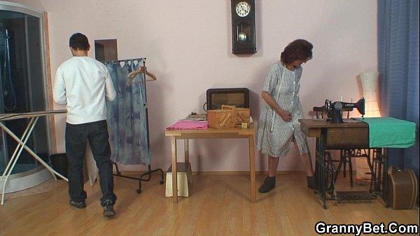Sewing old granny and boy  thumbnail