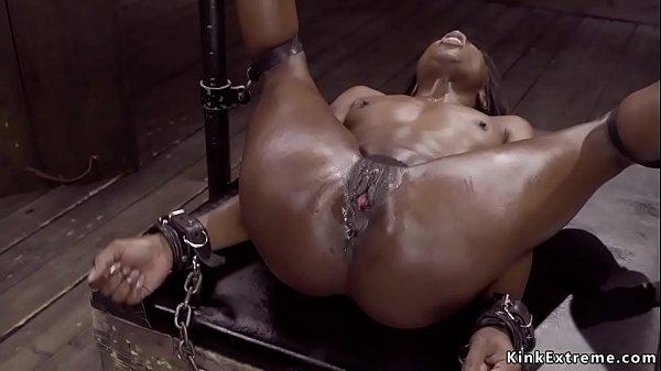 Ebony in device bondage is toyed Thumb
