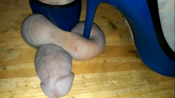 b. cock and ball trample in heels on a cockboard Thumb