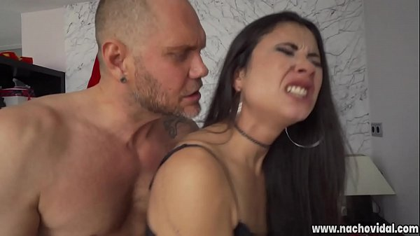 The beautiful 22-year-old Latina with a natural breast has a big smile and tattoos that decorate her shoulder, thighs and ass. She holds the huge penis in her mouth and gasps soaked in saliva.