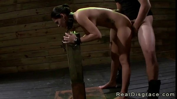 Chained brunette Jasmine Caro to a post gets throat and pussy fucked