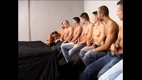 Experienced slut in black lingerie Evelin gives blowjob to ten muscular guys
