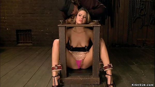 Bound blonde with gas mask is caned