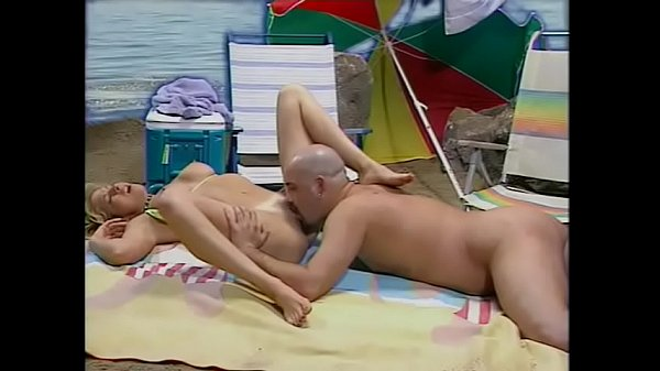 Hot blonde slut in the bikini suit Tara moans while she takes hard dick on her tight pussy during the picnic on the beach Thumb
