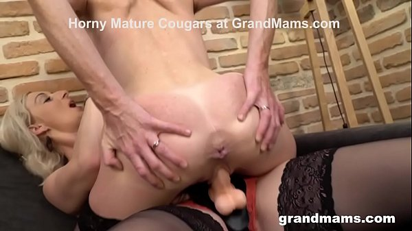 Kinky Granny Punishes Mature Babe with a Strap-On Thumb