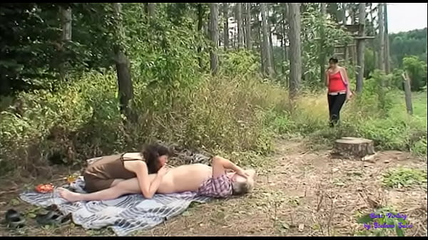 The slut sees two old men fucking in the open countryside and joins them