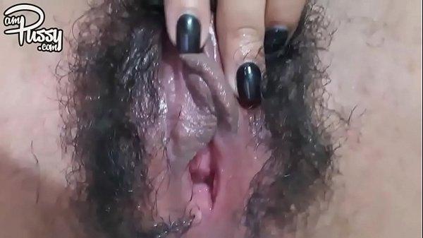 Extreme close-up hairy pussy masturbation