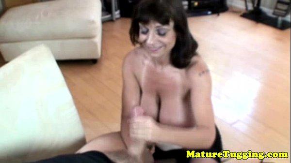 Busty granny giving tugjob