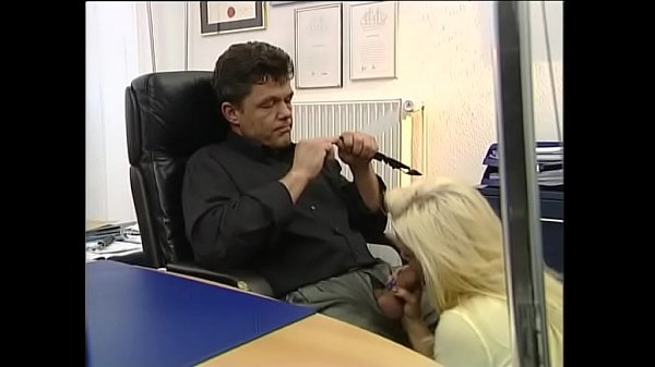Sexy blonde gives a blow job under the desk of her boss Thumb