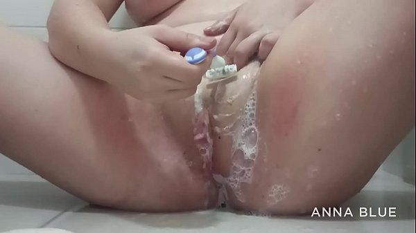 Redhead shows off to her lover in the bathroom and shaves her pussy before marrying a politician