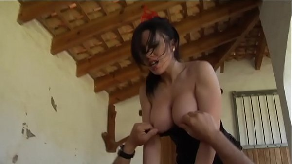 Brunette with amazing boobs banged in a barn