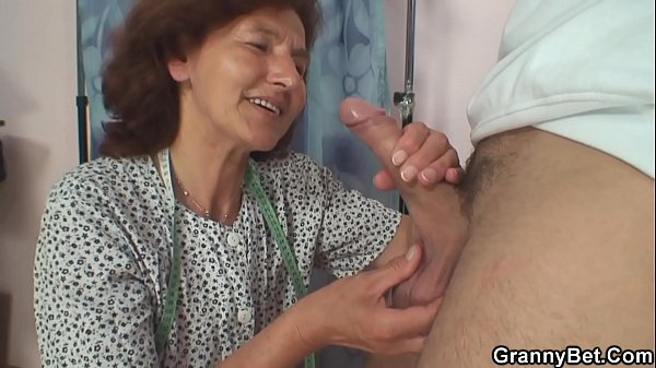 Sewing old granny swallows customer's cock Thumb