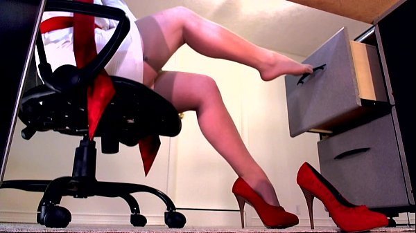 Perfect legs in nude stockings and red high heels