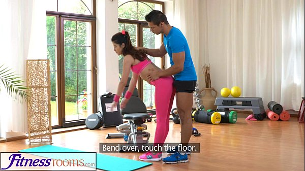 FitnessRooms Gym instructor pulls down her yoga...